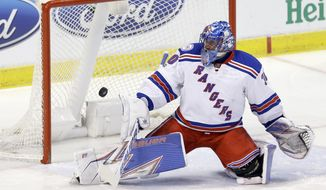 New York Rangers goalie Henrik Lundqvist (30) deflects a shot by the Florida Panthers in the first period of an NHL hockey game, Tuesday, March 7, 2017, in Sunrise, Fla. (AP Photo/Alan Diaz)