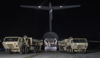 In this photo provided by U.S. Forces Korea, trucks carrying U.S. missile launchers and other equipment needed to set up the Terminal High Altitude Area Defense (THAAD) missile defense system arrive at the Osan air base in Pyeongtaek, South Korea, Monday, March 6, 2017. The U.S. military has begun moving equipment for the controversial missile defense system to ally South Korea. The announcement Tuesday by the U.S. military comes a day after North Korea test-launched four ballistic missiles into the ocean near Japan.  (U.S. Force Korea via AP)