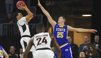 Omaha's Daniel Norl (13) takes a shot as South Dakota State's Lane Severyn (25) defends during the Summit League NCAA college basketball championship game, Tuesday, March 7, 2017, at the Denny Sanford Premier Center in Sioux Falls, S.D. (Joe Ahlquist/Argus Leader via AP)