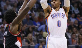 Oklahoma City Thunder guard Russell Westbrook (0) shoots over Portland Trail Blazers forward Al-Farouq Aminu, left, in the second quarter of an NBA basketball game in Oklahoma City, Tuesday, March 7, 2017. (AP Photo/Sue Ogrocki)