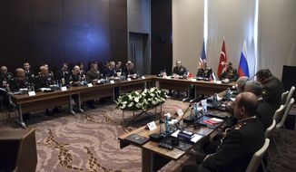 Turkey's Chief of Staff Gen. Hulusi Akar, center, U.S. Chairman of the Joint Chiefs of Staff Gen. Joseph Dunford, left, and Russia's Chief of Staff Gen. Valery Gerasimov and their delegations attend a meeting in the Mediterranean coastal city of Antalya, Turkey, Tuesday, March 7, 2017. Turkey's military says the Turkish, U.S. and Russian chiefs of military staff are meeting in southern Turkey to discuss developments in Syria and Iraq. The meeting comes amid renewed Turkish threats to hit U.S.-backed Syrian Kurdish targets in the northern Syrian city of Manbij. (Turkish Military, Pool Photo via AP)