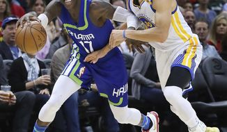 Atlanta Hawks guard Dennis Schroder takes it to the basket battling Golden State Warriors guard Stephen Curry during an NBA basketball game on Monday, March 6, 2017, in Atlanta. (Curtis Compton/Atlanta-Journal Constitution via AP)