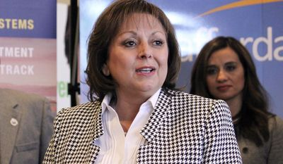 """FILE - In this Feb. 1, 2017 file photo, New Mexico Gov. Susana Martinez talks about the economic impact of a contract to install solar panels to power Facebook's new data center, at a news conference in Albuquerque. Martinez said Tuesday, March 7, 2017 that state lawmakers' focus on """"meaningless bills"""" may force her to call a special session. (AP Photo/Susan Montoya Bryan, File)"""