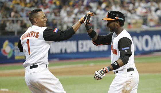Netherlands's Jurickson Profar, right, celebrate with Xander Bogaerts after winning against Taiwan at the first round game of the World Baseball Classic at Gocheok Sky Dome in Seoul, South Korea, Wednesday, March 8, 2017. (AP Photo/Ahn Young-joon).