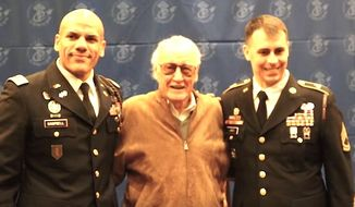 Stan Lee poses with soldiers after his induction into the U.S. Army's Signal Corps Regimental Association, March 3, 2017. (YouTube, 1-2 Stryker Brigade Combat Team)