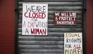 "Signs are posted at the Grindcore House restaurant shuttered in solidarity with ""A Day Without a Woman"" in Philadelphia, Wednesday, March 8, 2017. Organizers of January's Women's March are calling on women to stay home from work and not spend money in stores or online to show their impact on American society. (AP Photo/Matt Rourke)"