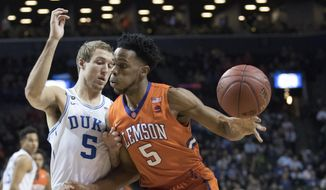 Duke guard Luke Kennard, left, guards Clemson forward Jaron Blossomgame during the first half of an NCAA college basketball game in the Atlantic Coast Conference tournament, Wednesday, March 8, 2017, in New York. (AP Photo/Mary Altaffer)