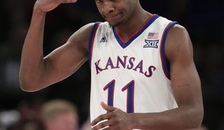 FILE - In this Nov. 15, 2016, file photo, Kansas guard Josh Jackson reacts after hitting a 3-point shot against Duke during the second half of an NCAA college basketball game in New York. Jackson was selected as the All-Big 12 Newcomer of the Year, Monday, March 6, 2017.  (AP Photo/Julie Jacobson, File)