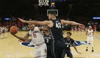 Georgetown's Bradley Hayes (42) defends as St. John's Malik Ellison (0) drives to the basket during the first half of an NCAA college basketball game during the Big East men's tournament Wednesday, March 8, 2017, in New York. (AP Photo/Frank Franklin II)