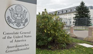 CORRECTS SLUG - FILE - This Oct. 28, 2013 file photo shows the US Consulate General in Frankfurt, Germany. WikiLeaks on Tuesday, March 7, 2017 published thousands of documents purportedly taken from the Central Intelligence Agency's Center for Cyber Intelligence, a dramatic release that appears to expose intimate details of America's cyberespionage toolkit. (Boris Roessler/dpa via AP, file)
