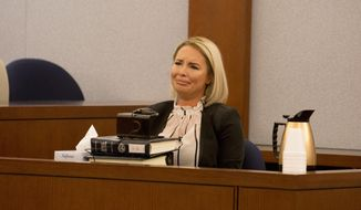 Christine Mackinday, the victim and ex-girlfriend of former mixed martial arts fighter War Machine, also known as Jonathan Koppenhaver, gives her testimony during his sexual assault and attempted murder at the Regional Justice Center, Wednesday, March 8, 2017, Las Vegas.  (Elizabeth Brumley/Las Vegas Review-Journal via AP)