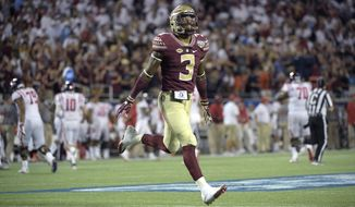 FILE - In this Sept. 6, 2016, file photo, Florida State defensive back Derwin James (3) celebrates after an interception by defensive back Tarvarus McFadden during the second half of an NCAA college football game against Mississippi in Orlando, Fla. James was supposed to be one of the top sophomores in the nation last season but played in just two games due to a knee injury. James is taking part in spring drills and is trying his hand at an additional position _ punt returner.  (AP Photo/Phelan M. Ebenhack, File)