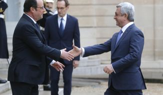 France's President Francois Hollande, left, welcomes Armenia's President Serge Sarkissian at the Elysee Palace, Wednesday, March 8, 2017. (AP Photo/Michel Euler)