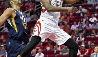 Houston Rockets guard James Harden, right, drives past Utah Jazz center Rudy Gobert in the first half of an NBA basketball game, Wednesday, March 8, 2017, in Houston. (AP Photo/Eric Christian Smith)