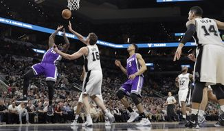 Sacramento Kings guard Ty Lawson (10) sis fouled by San Antonio Spurs center Pau Gasol (16) as he tries to score during the first half of an NBA basketball game, Wednesday, March 8, 2017, in San Antonio. (AP Photo/Eric Gay)
