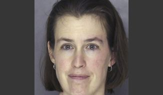 This Tuesday, April 1, 2014 booking photo provided by the Allegheny County Police shows Laurel Michelle Schlemmer, who is accused of drowning her two young sons in a bathtub. In opening statements of of Schlemmer's bench trial a prosecutor said Schlemmer, the 43-year-old McCandless, Pa., woman, who is charged with killing 6-year-old Daniel and 3-year-old Luke in April 2014 so she could focus on raising their older brother, had tried to kill the boys before. (AP Photo/Allegheny County Police)