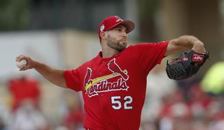 St. Louis Cardinals starting pitcher Michael Wacha (52) delivers in the first of a spring training baseball game against the Washington Nationals Wednesday, March 8, 2017, in Jupiter, Fla. (AP Photo/John Bazemore)