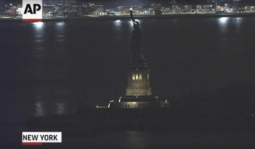 """This Tuesday, March 7, 2017, still image taken from video shows the Statue of Liberty in New York. For several hours, Lady Liberty didn't shine so brightly. The famed The Statue of Liberty was temporarily in the dark Tuesday night , March 7, 2017, after what a spokesman calls an """"unplanned outage."""" (AP Photo)"""
