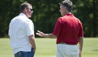 Washington Redskins general manager Scot McCloughan, left, talks with team president Bruce Allen during an NFL football organized team activity at Redskins Park, on Tuesday, May 26, 2015, in Ashburn, Va. (AP Photo/Evan Vucci)