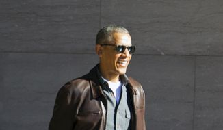 Former President Barack Obama leaves the National Gallery of Art in Washington, Sunday, March 5, 2017. President Trump has accused former President Barack Obama of tapping his phones at Trump Tower the month before the election, without offering any evidence. ( AP Photo/Jose Luis Magana)