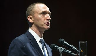Carter Page, then adviser to U.S. Republican presidential candidate Donald Trump, speaks at the graduation ceremony for the New Economic School in Moscow, Russia, in this Friday, July 8, 2016, file photo. Page, once a little-known investment banker-turned-adviser in the outer circle of the improbable Trump campaign, is emerging as a central figure in the controversy surrounding campaign connections to Russia. (AP Photo/Pavel Golovkin, File)