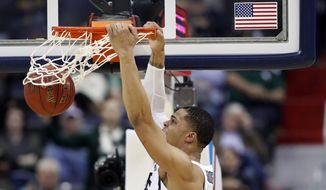 Michigan State guard Miles Bridges (22) dunks the ball in front of Penn State guard Josh Reaves (23) during the first half of an NCAA college basketball game in the Big Ten tournament, Thursday, March 9, 2017, in Washington. (AP Photo/Alex Brandon)