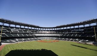 Construction crews work on the infield at SunTrust Park, the Atlanta Braves' new baseball stadium in Atlanta, Thursday, March 9, 2017. With only about three weeks remaining before the Braves return from spring training to play the Yankees in an exhibition game, finishing touches are being placed on the team's new suburban SunTrust Park. (AP Photo/David Goldman)