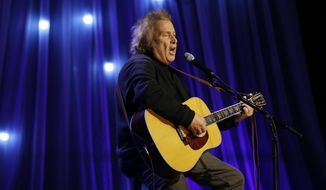 "In this Tuesday, Dec. 13, 2016, photo, Don McLean performs during a taping of Dolly Parton's Smoky Mountain Rise Telethon in Nashville, Tenn. Court officials said Wednesday, March 8, 2017, that a Maine court has given the ex-wife of ""American Pie"" singer McLean an order of protection against him. (AP Photo/Mark Humphrey)"