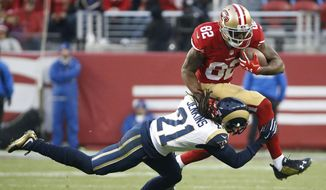 FILE - In this Jan. 3, 2016, file photo, San Francisco 49ers wide receiver Torrey Smith (82) tries to jump over St. Louis Rams cornerback Janoris Jenkins (21) during overtime of an NFL football game in Santa Clara, Calif. The Philadelphia Eagles have signed Smith to a three-year contract on Thursday, March 9, 2017. Smith was released by the 49ers last week. (AP Photo/Tony Avelar, File)