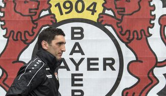 Leverkusen's new coach Tayfun Korkut seen during a press conference of German Bundesliga soccer club Bayer 04 Leverkusen in Leverkusen, Germany, Monday, March 6, 2017. Bayer Leverkusen has hired former Turkey international Tayfun Korkut as coach to rescue something from the club's worst Bundesliga season in 14 years.  (Federico Gambarini/dpa via AP)