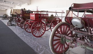Fire fighting equipment is being prepared for an Americana auction Saturday, March 11 at the Indianapolis Motor Speedway of items that had been housed at the track, and in Terre Haute, in Indianapolis, Wednesday, March 8, 2017. The proceeds will benefit the IMS Museum. Betsy Smith, the director of the nonprofit foundation that runs the museum says that no race cars or racing memorabilia will be sold at the auction.  (Robert Scheer/The Indianapolis Star via AP)