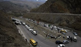 Vehicles carrying Afghan nationals, travel through Pakistan's famous Khyber Pass en route to neighboring Afghanistan in Pakistan, Tuesday, March 7, 2017. Thousands of Afghans gathered at the Pakistani border to return home on Tuesday as Pakistan temporarily reopened two main crossings that had been closed last month after a wave of militant attacks. (AP Photo/Muhammad Sajjad)