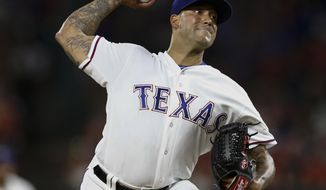 FILE - In this July 8, 2016, file photo, Texas Rangers relief pitcher Matt Bush delivers to the Minnesota Twins during the eighth inning of a baseball game, in Arlington, Texas. Bush felt normal on the mound as a 30-year-old rookie for the Rangers last season, like he was always meant to be there. The reliever knows he could have been there sooner if not for his struggles off the field that culminated with a drunken driving crash that sent him to prison for 3 1/2 years. (AP Photo/Jim Cowsert, File)