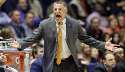 Auburn coach Bruce Pearl yells at an official during the first half of the team's NCAA college basketball game against Missouri at the Southeastern Conference tournament Wednesday, March 8, 2017, in Nashville, Tenn. (AP Photo/Wade Payne)