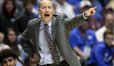 Texas A&M head coach Billy Kennedy directs his team during the second half of an NCAA college basketball game against Vanderbilt at the Southeastern Conference tournament Thursday, March 9, 2017, in Nashville, Tenn. (AP Photo/Wade Payne)