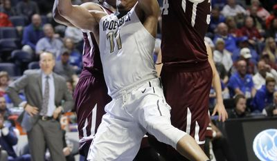 Vanderbilt forward Jeff Roberson (11) battles for a rebound with Texas A&M forward Robert Williams, left, and center Tyler Davis, right, during the first half of an NCAA college basketball game at the Southeastern Conference tournament Thursday, March 9, 2017, in Nashville, Tenn. (AP Photo/Wade Payne)