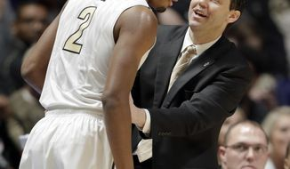 Vanderbilt head coach Bryce Drew talks with guard Joe Toye (2) during the first half of an NCAA college basketball game against Texas A&M at the Southeastern Conference tournament Thursday, March 9, 2017, in Nashville, Tenn. (AP Photo/Wade Payne)