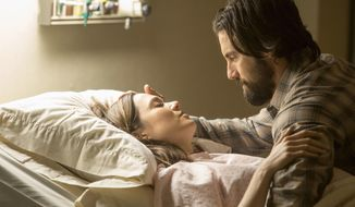 """This image released by NBC shows Mandy Moore, left, and Milo Ventimiglia in a scene from """"This Is Us."""" The season finale for the popular  time-twisting family drama will air Tuesday at 9 p.m. EST on NBC. (Ron Batzdorff/NBC via AP)"""