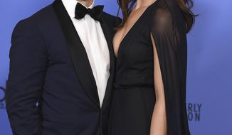 FILE - This Jan. 8, 2017 file photo shows Milo Ventimiglia, left, and Mandy Moore in the press room at the 74th annual Golden Globe Awards in Beverly Hills, Calif. The season finale for the popular  time-twisting family drama will air Tuesday at 9 p.m. EST on NBC. (Photo by Jordan Strauss/Invision/AP, File)