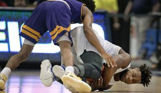 SMU's Semi Ojeleye dives for a loose ball as East Carolina's Jeremy Sheppard, top, defends, during the first half of an NCAA college basketball game in the American Athletic Conference tournament quarterfinals, Friday, March 10, 2017, in Hartford, Conn. (AP Photo/Jessica Hill)