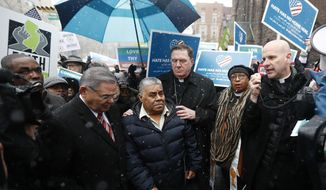 Catalino Guerrero, center left, stands with U.S. Sen. Bob Menendez, left, and Newark Archbishop Cardinal Joseph Tobin, center right, during a rally outside of the Peter Rodino Federal Building before attending an immigration hearing, Friday, March 10, 2017, in Newark, N.J. Guerrero, who arrived in the U.S. illegally in 1991, is facing deportation. Organizers claim he is an upstanding citizen and should not be deported. (AP Photo/Julio Cortez)