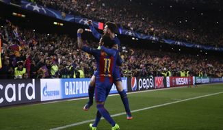 Barcelona's Lionel Messi celebrates with Neymar their victory at the end of the Champion League round of 16, second leg soccer match against Paris Saint Germain at the Camp Nou stadium in Barcelona, Spain, Wednesday March 8, 2017. (AP Photo/Emilio Morenatti)