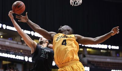 Long Beach State's Temidayo Yussuf, left, and Hawaii's Gibson Johnson reach for a rebound during the first half of an NCAA college basketball game at the Big West men's tournament Thursday, March 9, 2017, in Anaheim, Calif. (AP Photo/Jae C. Hong)