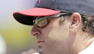 """FILE - In this Aug. 7, 2016, file photo, St. Louis Cardinals manager Mike Matheny watches from the dugout in the second inning of a baseball game against the Atlanta Braves in St. Louis. Matheny has taken on a new role this spring, the Cardinals' self-proclaimed """"glove breakerinner guy,"""" working over new leather during his spare time. (AP Photo/Tom Gannam, File)"""