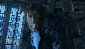 """This image released by Disney shows Dan Stevens as The Beast in a live-action adaptation of the animated classic """"Beauty and the Beast."""" (Disney via AP)"""