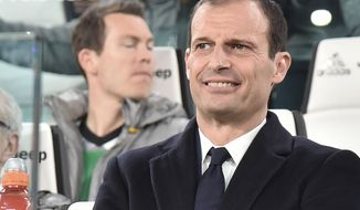 Juventus' coach Massimiliano Allegri smiles during the Italian Serie A soccer match between Juventus and Milan at the Juventus stadium in Turin, Italy, Friday, March 10, 2017. (Andrea Di Marco/ANSA via AP)