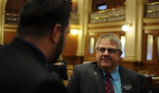 House Majority Leader Lee Qualm speaks after lawmakers approved the fiscal year 2018 state budget in Pierre, S.D., Friday, March 10, 2017. (AP Photo/James Nord)
