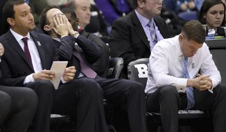 Minnesota head coach RIchard Pitino, center, reacts after his team was charged with a foul during the second half of an NCAA college basketball game against Michigan in the Big Ten tournament, Saturday, March 11, 2017, in Washington. Michigan won 84-77. (AP Photo/Nick Wass)