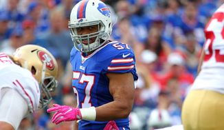 FILE - In this Oct. 16, 2016 file photo, Buffalo Bills outside linebacker Lorenzo Alexander (57) lines up against the San Francisco 49ers during the first half of an NFL football game in Orchard Park, N.Y. The Bills have agreed to re-sign Alexander, their top pass-rusher, to a two-year, $9 million contract. That's a considerable increase in pay for the 33-year-old Alexander, who was supposed to play a backup and special teams role in signing a one-year $885,000 deal with the Bills last spring. (AP Photo/Bill Wippert, File)