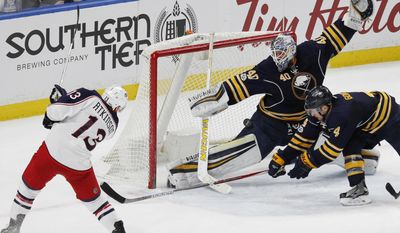 Buffalo Sabres goalie Robin Lehner (40) stops Columbus Blue Jackets forward Cam Atkinson (13) during the final seconds of an NHL hockey game, Saturday, March 11, 2017, in Buffalo, N.Y. (AP Photo/Jeffrey T. Barnes)